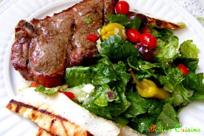 Grilled NY strip & chicken breast with mediterranean salad