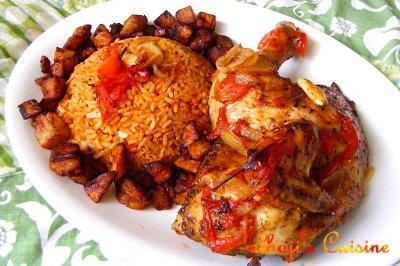 Jollof rice with herb baked chicken & fried plantain
